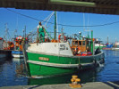 Fisherman on his boat in Kalk Bay Harbour
